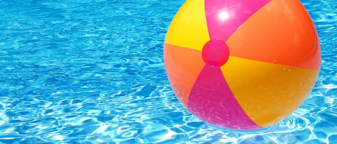 beach ball floating in pool water
