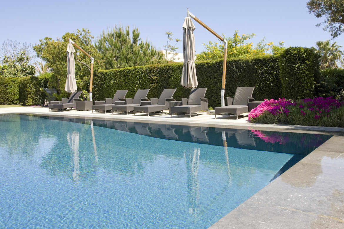 resort style pool with chairs